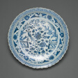 Shallow Dish with Long-Tailed Birds in a Garden of Stylized Peonies and Fronds, Encircled by a Scrolling Wreath of Camellia and Lotus Blossoms