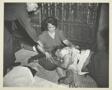 Manuel Jiminez lies wounded in the lap of Manuelda Hernandez