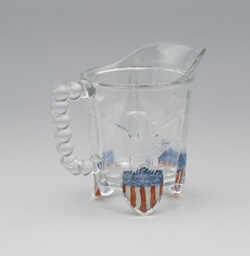 """Bullet & Emblem"" pattern cream pitcher"