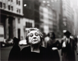 Woman on the Street with Her Eyes Closed
