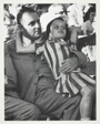 Man Holding Small Girl on His Lap