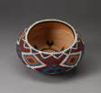 Polychrome Beaded Basket with Repeated Diamond and Triangle Motifs