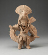 Dancing Figure Wearing Animal Headdress and Ornate Costume