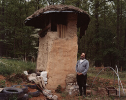 Albert Bates next to a Dry Composting Toilet at the Farm Ecovillage, Summertown, Tennessee