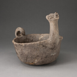 Bowl in the Shape of Underwater Serpent with Upturned Neck and Coiled Tail