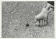 Hand About to Shoot a Marble
