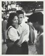 Boy Embracing Girl at a Picnic