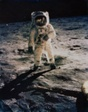Buzz Aldrin on the Moon with Scene Reflected in his Face Covering and Footprints on Ground