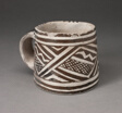 Mug with Interlocking Geometric Pattern with Zigzag Motifs and Crosshatching