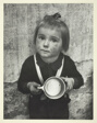 Little Girl Holding Cup
