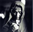Qurban Gul Holding a Photograph of Her Son Mula Awaz, Khairabad, Northern Pakistan