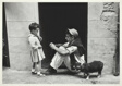 Pamploma: Man, Child and Dog in Doorway
