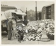 John Q. Public visits the dump at 19th st. and Wolcott av. with James J. Creed, superintendent of the city dumps, and Mrs. Walter J. Kelly, head of the OCD's waste fats salvage division, where he is shown how tin cans picked up by city garbage trucks are deposited for shipment to detinning plants.