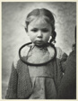 Little Girl with Ring Around Neck